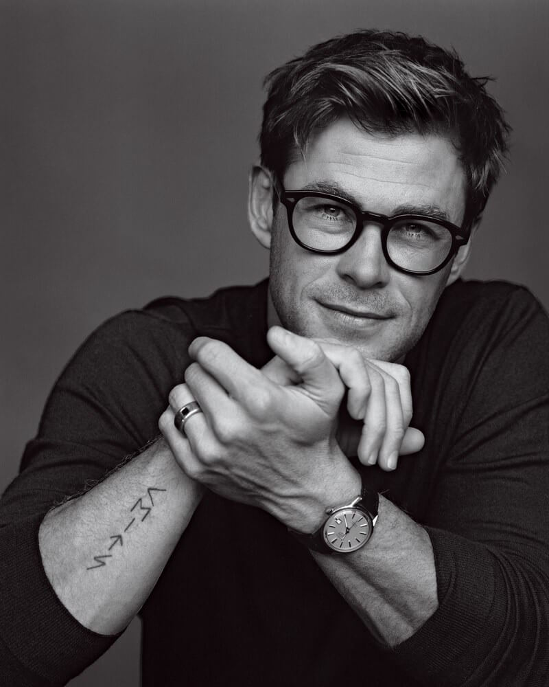 """Chris Hemsworth """"CEITS"""" Tattoo + Meaning"""