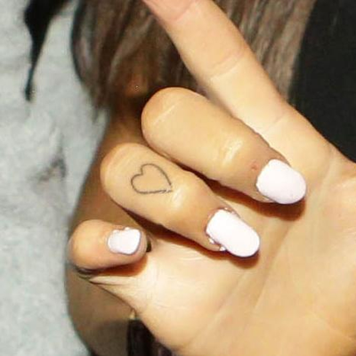 Heart Tattoo On Her Right-Hand Finger